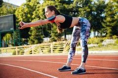 Female athlete doing stretching exercises outdoors Royalty Free Stock Image