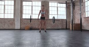 Female athlete doing weight lifting workout stock footage