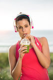 Female athlete drinking detox smoothie Stock Photos