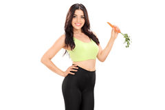 Female athlete eating a carrot Stock Images