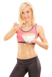 Female athlete eating cereal from a bowl Stock Image