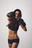 Female athlete exercising boxing Stock Photography