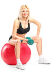 Female athlete exercising with dumbbell Royalty Free Stock Photography