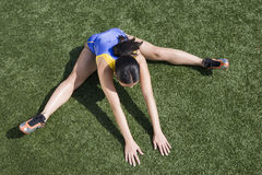 Female Athlete Exercising On Field Royalty Free Stock Images