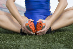 Female Athlete Exercising On Grass Stock Photography