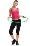 Female athlete exercising with a hula-hoop Stock Photography