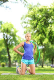 Female athlete on an exercising mat holding a hula hoop Stock Photos