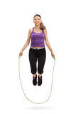 Female athlete exercising with a skipping rope Stock Image