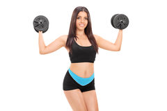 Female athlete exercising with two barbells Stock Photo