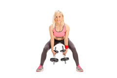 Female athlete exercising with two small barbells Royalty Free Stock Photo