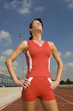 Female Athlete With Eyes Closed. In stadium royalty free stock photography
