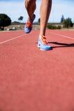 Female athlete feet running on the running track Stock Photography