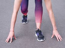 Female feet start to run in running shoes. Stock Photography