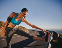 Female athlete getting ready for a run Royalty Free Stock Photography