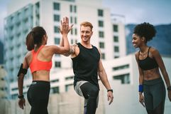 Fitness people relaxing after workout standing on rooftop royalty free stock photos