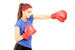 Female athlete hitting with red boxing gloves stock images