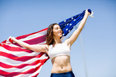 Female athlete holding an american flag Royalty Free Stock Photos