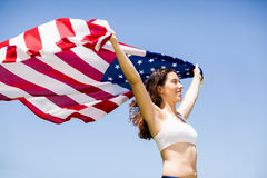 Female athlete holding an american flag Royalty Free Stock Images