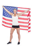 Female athlete holding American flag Stock Images