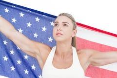 Female athlete holding American flag Stock Photography