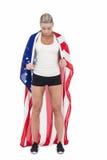 Female athlete holding American flag Stock Photos