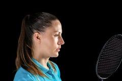 Female athlete holding badminton racket royalty free stock photo