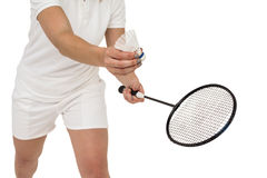 Female athlete holding a badminton racquet ready to serve Royalty Free Stock Photo