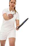Female athlete holding a badminton racquet ready to serve Stock Photos