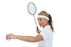 Female athlete holding a badminton racquet ready to serve Stock Image