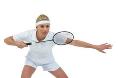 Female athlete holding a badminton racquet ready to serve Stock Photography