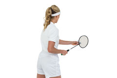 Female athlete holding a badminton racquet ready to serve Stock Images