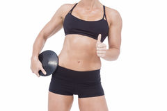 Female athlete holding discus and showing thumbs up Royalty Free Stock Image