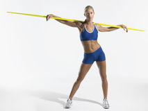 Female athlete holding javelin behind shoulders Stock Photo