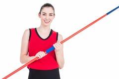 Female athlete holding a javelin. On white background Stock Image