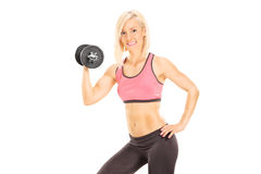 Female athlete holding a small weight Stock Photography
