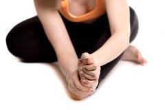 Female athlete holding sore foot, close up of female legs Stock Photos