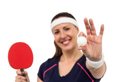 Female athlete holding table tennis paddle and ball Stock Photos