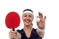 Female athlete holding table tennis paddle and ball Royalty Free Stock Image