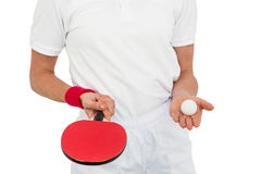 Female athlete holding table tennis paddle and ball Royalty Free Stock Photos