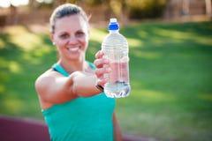Female athlete holding a water bottle Stock Image