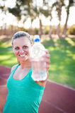 Female athlete holding a water bottle Stock Image