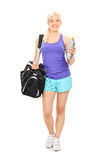 Female athlete holding a water bottle Stock Photo