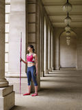 Female Athlete With Javelin In Portico Royalty Free Stock Photography