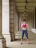Female Athlete With Javelin In Portico Stock Photo