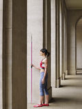 Female Athlete With Javelin In Portico Royalty Free Stock Images