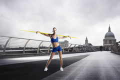 Female Athlete with javelin standing in front of St Paul's Cathedral in London Stock Photography