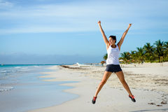 Female athlete jumping at beach Royalty Free Stock Photo