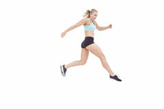 Female athlete jumping Royalty Free Stock Images