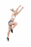 Female athlete jumping Royalty Free Stock Photos