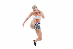Female athlete jumping Royalty Free Stock Photo